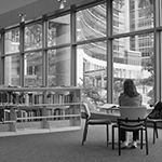 womansittinginalibrary